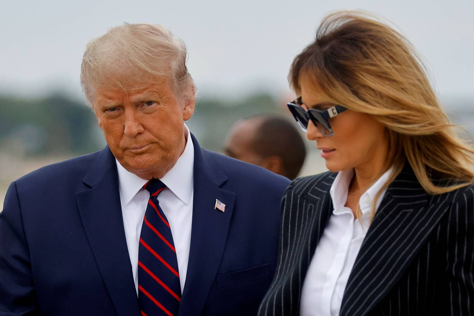 FILE PHOTO: U.S. President Donald Trump and first lady Melania Trump arrive at Cleveland Hopkins International Airport to participate in the first presidential debate with Democratic presidential nominee Joe Biden in Cleveland, Ohio