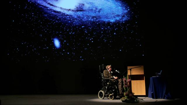 """FILE PHOTO: British physicist Stephen Hawking delivers a lecture on """"The Origin of the Universe"""" in Brussels"""