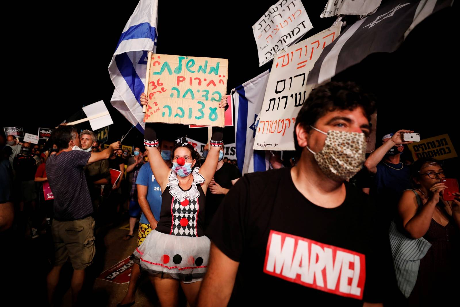 Israelis protest against government's handling of COVID-19 crisis, in Tel Aviv