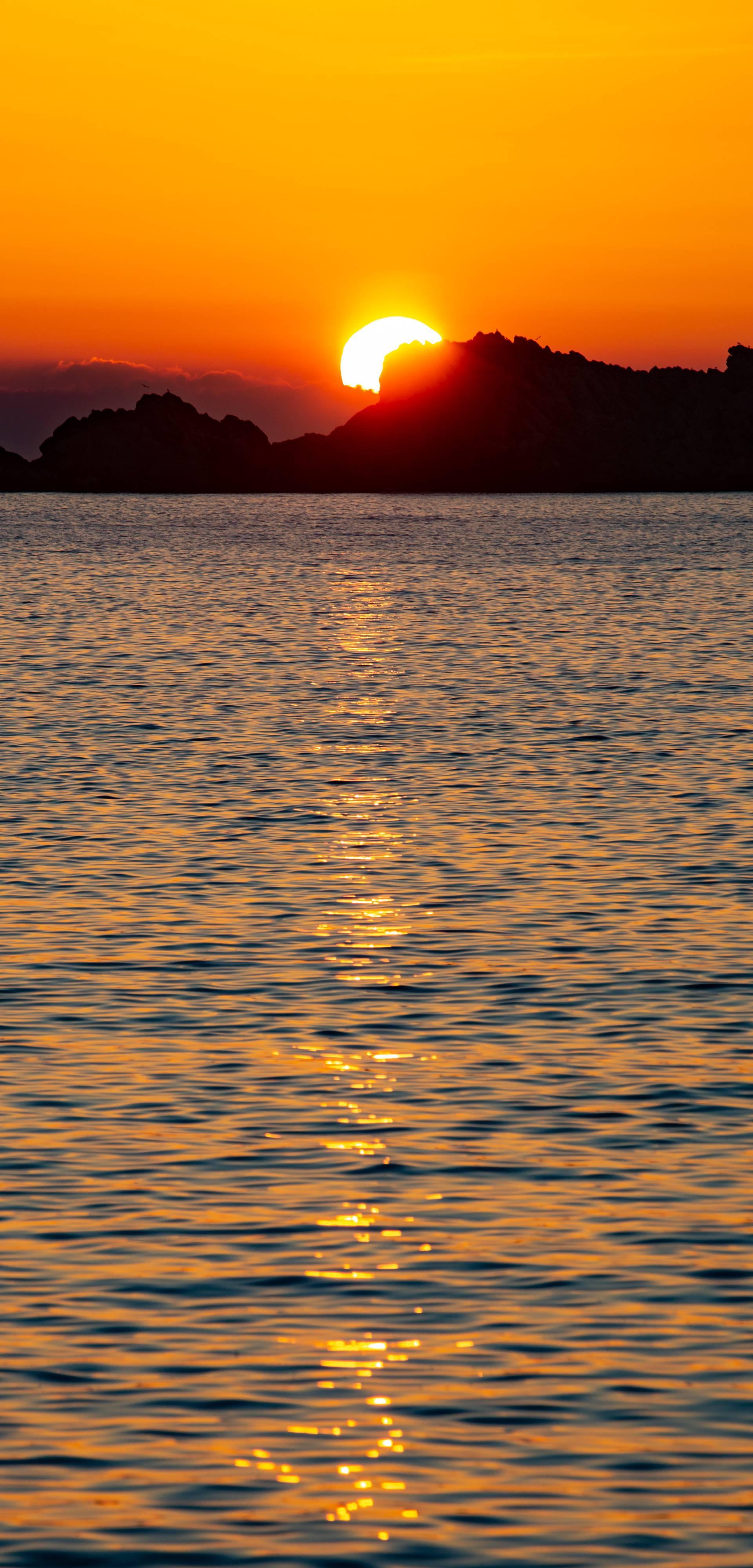Zalaz sunca za Grebenima u uvali Lapad