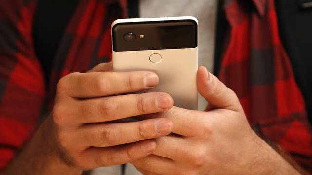 People try out Google's Pixel 2 phones during a launch event in San Francisco