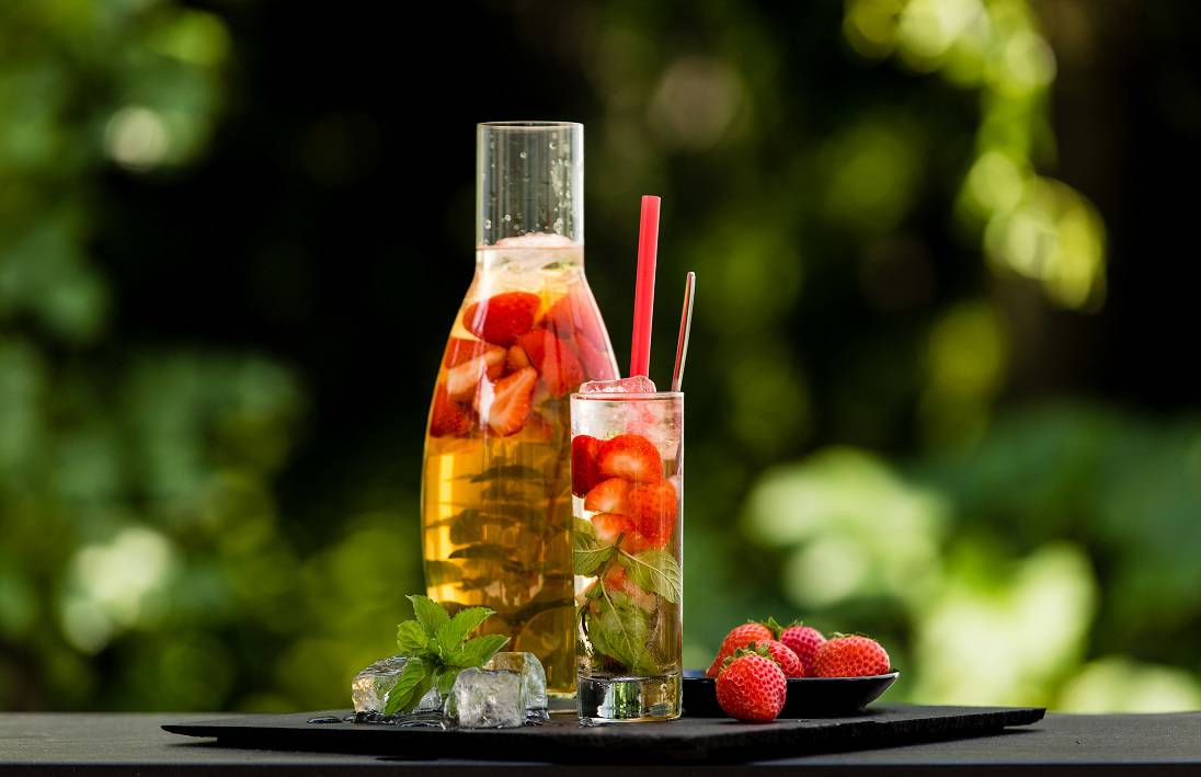 Homemade strawberry ice tea in the garden