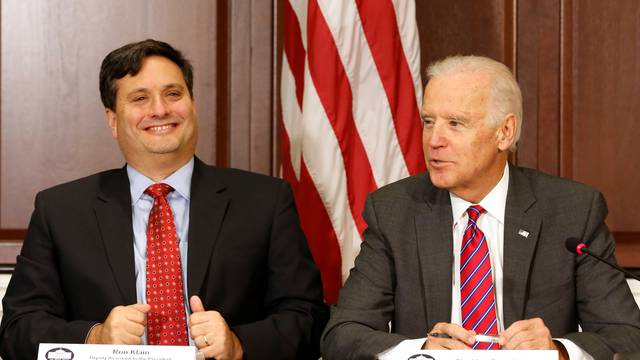 FILE PHOTO - U.S. Vice President Joe Biden is joined by Ebola Response Coordinator Ron Klain (L) in the Eisenhower Executive Office Building on the White House complex in Washington
