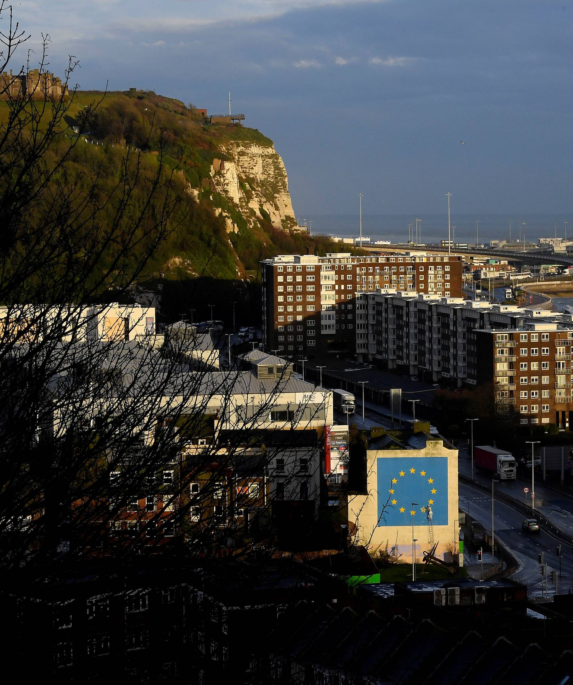 FILE PHOTO: A large mural depicting the EU flag being chipped away and attributed to the British artist Banksy is seen at the Port of Dover in south east Britain
