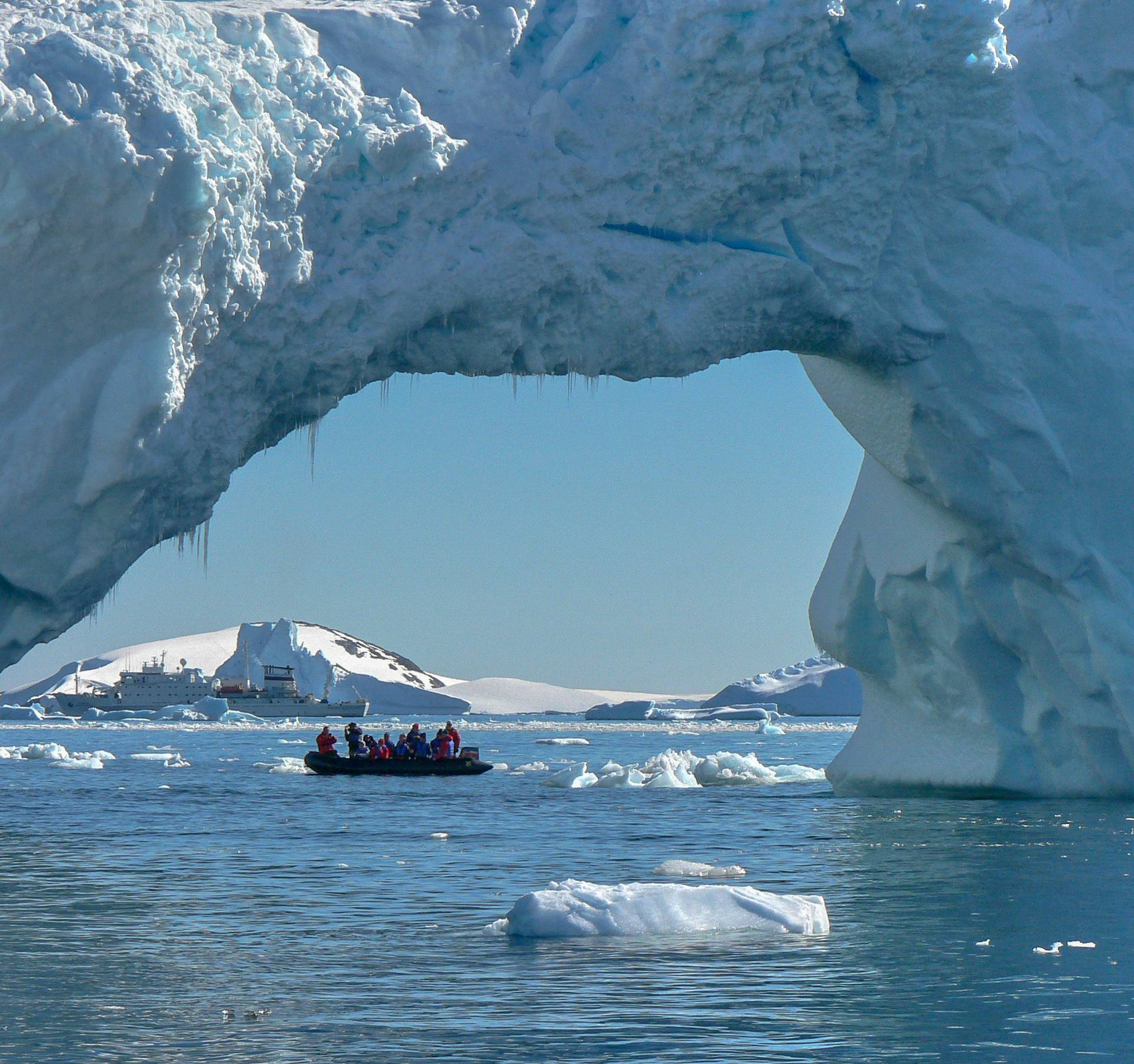 Large ice arch in iceberg in Antarctica