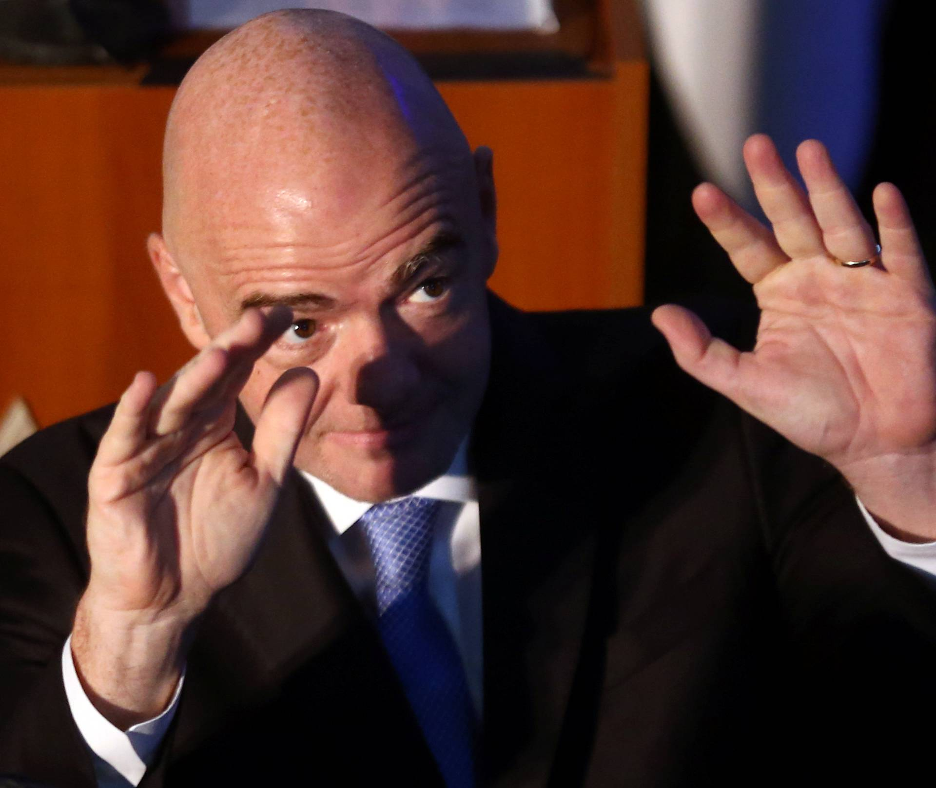 FIFA president Infantino waves as he arrives at the AFA headquarters in Buenos Aires