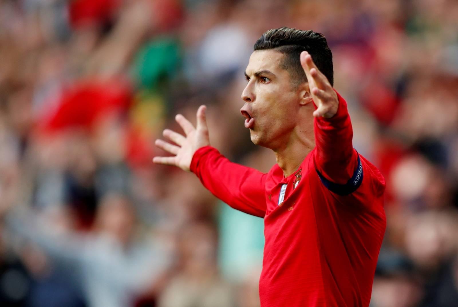 FILE PHOTO: Cristiano Ronaldo celebrates the first of his three goals in Portugal's 3-1 win over Switzerland in the UEFA Nations League semi-final at Estadio do Dragao in Porto.