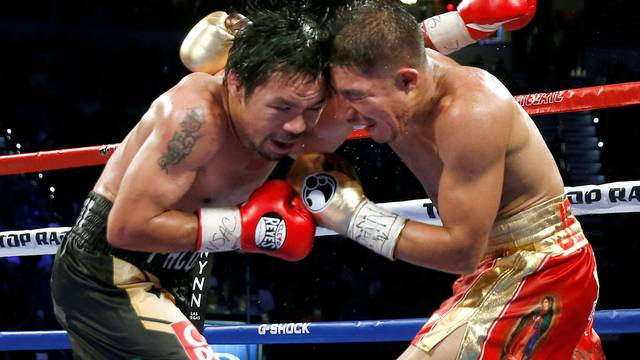Pacquiao and Vargas butt heads during their title fight at the Thomas & Mack Center in Las Vegas