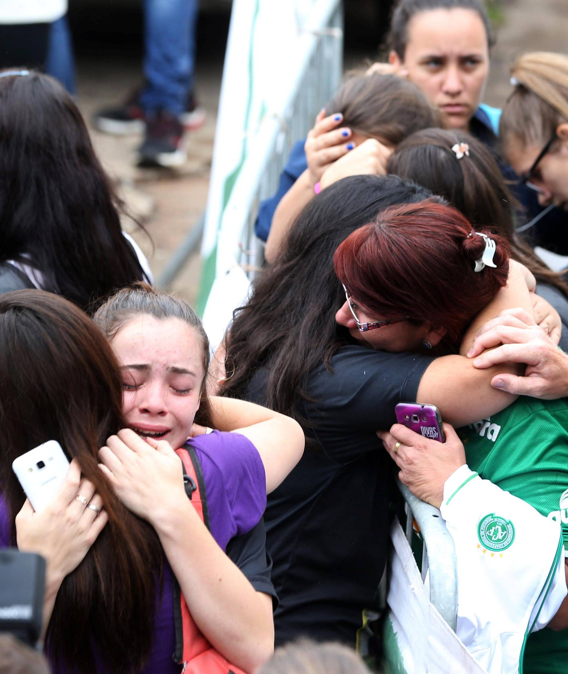 Fans of Chapecoense soccer team react in front of the Arena Conda stadium in Chapeco