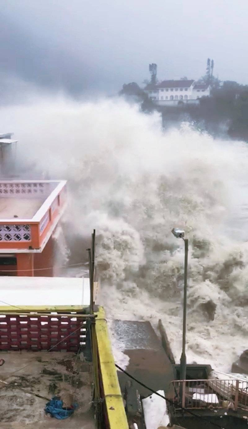 A giant wave strikes the coast in Hong Kong during Typhoon Mangkhut