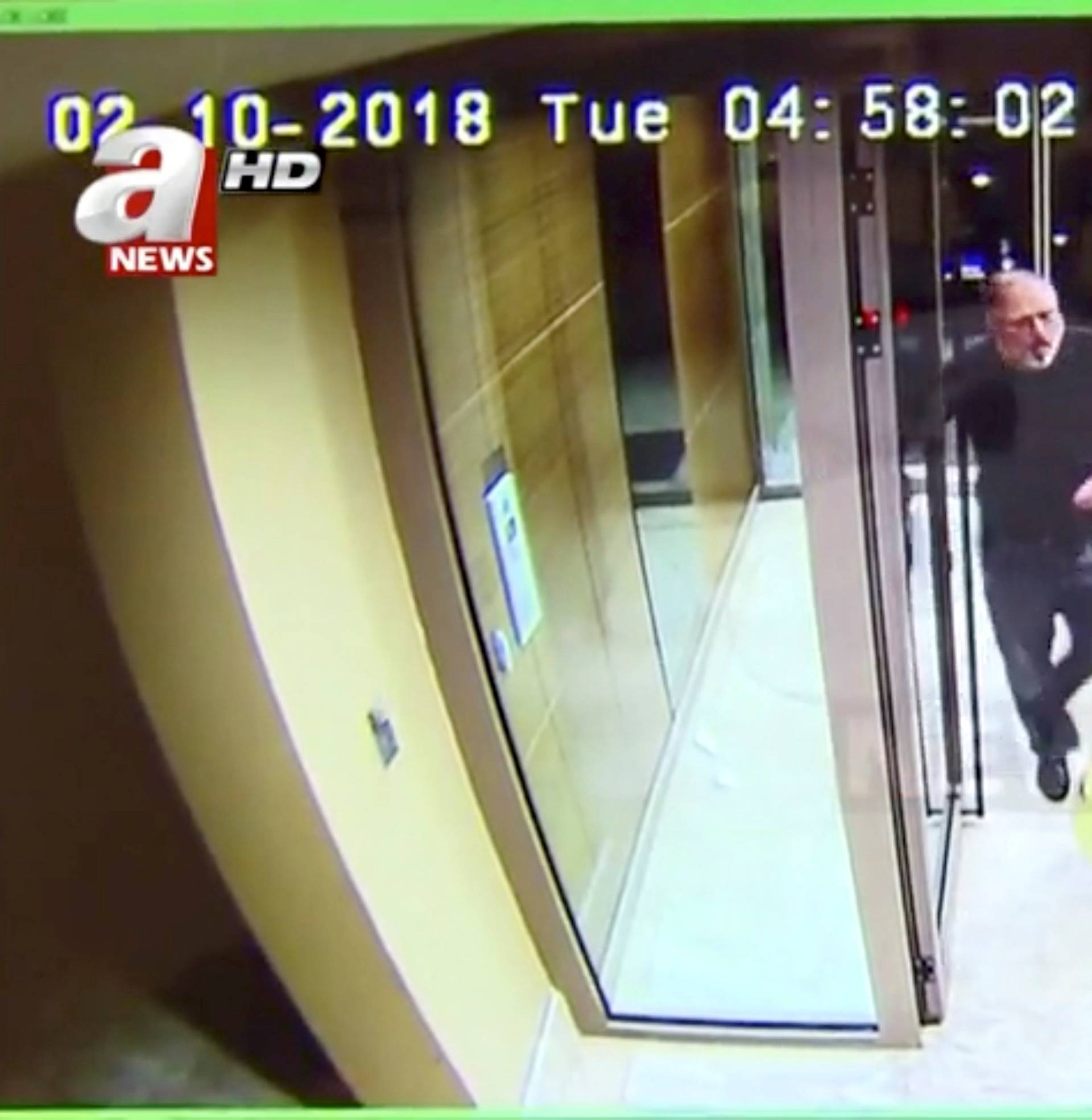 Still image taken from CCTV video supports to show Khashoggi and his fiancee entering their residence