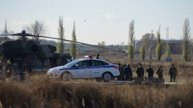 Russian military officials gather at a base after a conscript soldier killed fellow servicemen in Voronezh Region