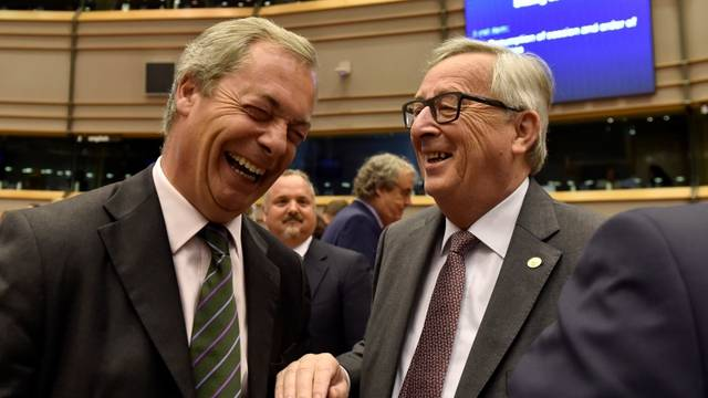 """EC President Juncker welcomes Farage, the leader of the UKIP, prior to a plenary session at the European Parliament on the outcome of the """"Brexit"""" in Brussels"""