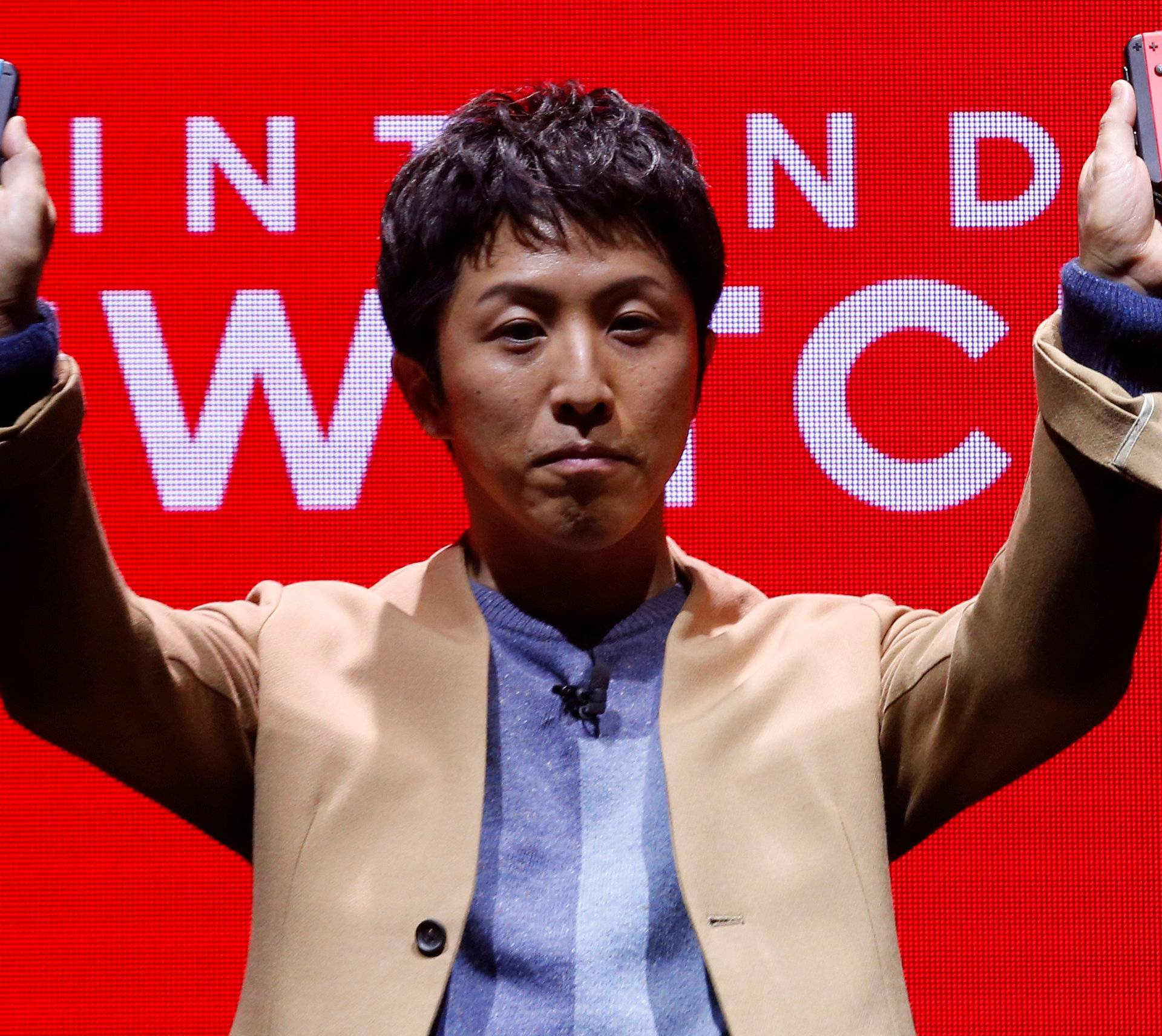 Nintendo Switch General Director Kouichi Kawamoto introduces the Switch, Nintendo's new game console, at a presentation ceremony in Tokyo