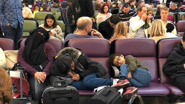 Stranded passengers are seen sleeping at Gatwick Airport