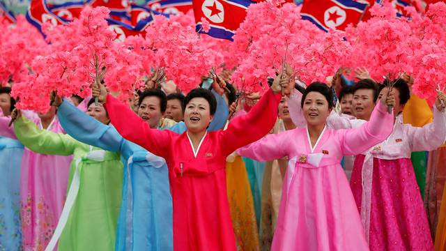People react as they see North Korean leader Kim Jong Un during a mass rally and parade in Pyongyang