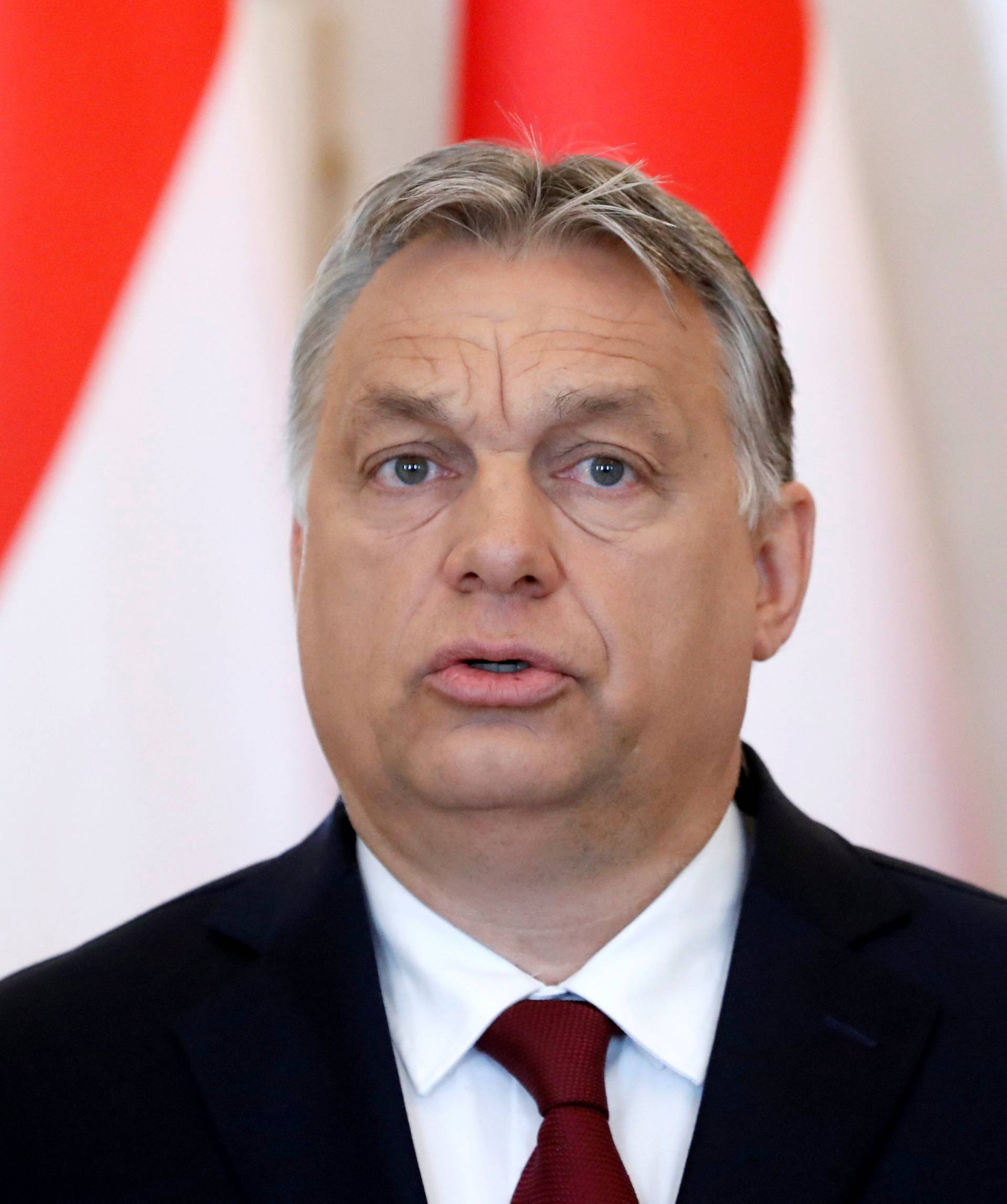 Hungarian PM Orban gives a statement to the media at the Presidential Palace in Budapest