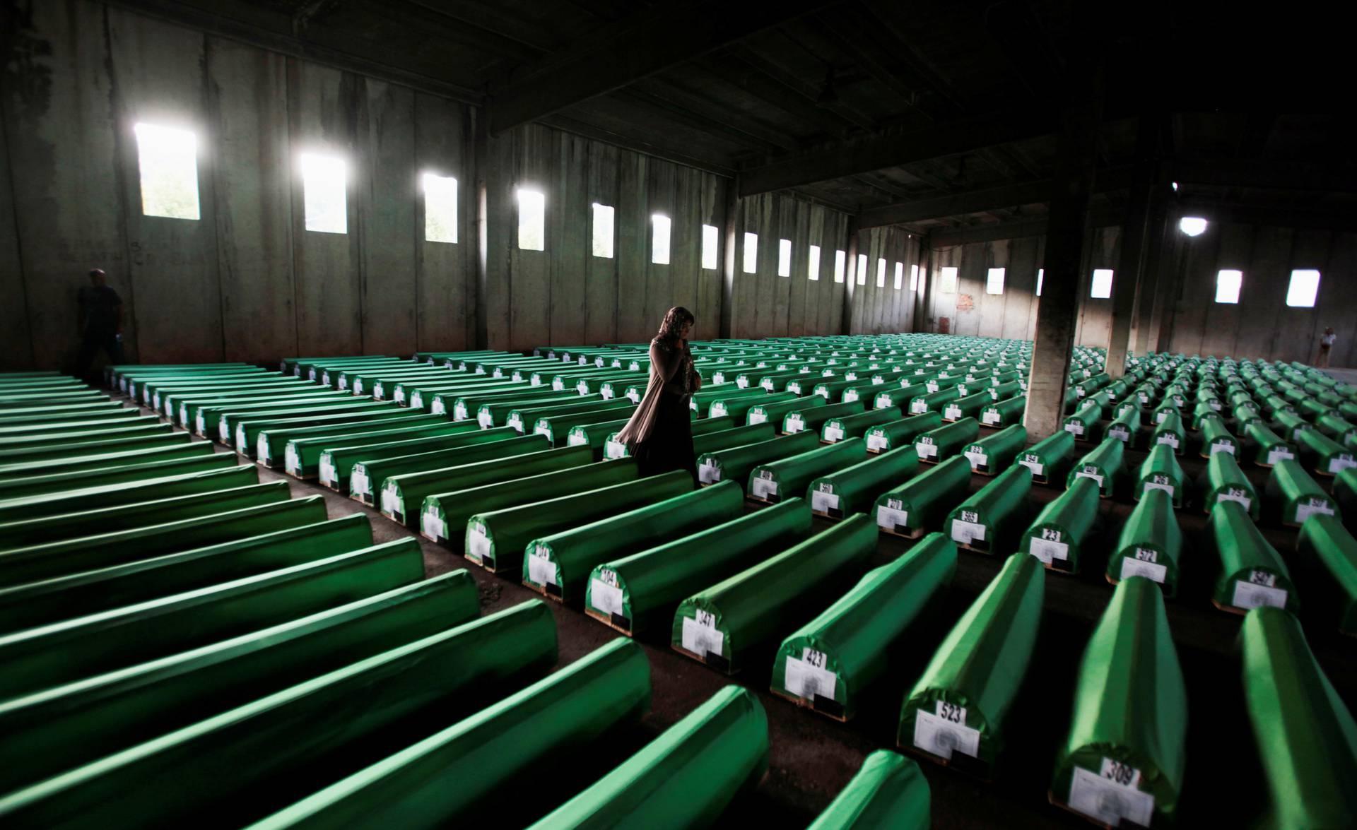 FILE PHOTO: Bosnian Muslim woman searches coffins in Potocari
