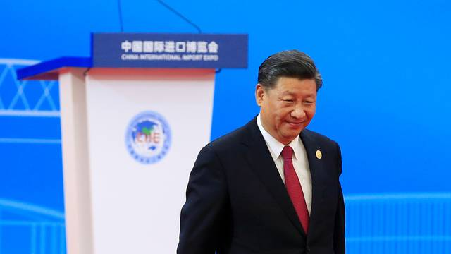 Chinese President Xi Jinping returns to his seat following his speech at the opening ceremony of the second China International Import Expo (CIIE) in Shanghai