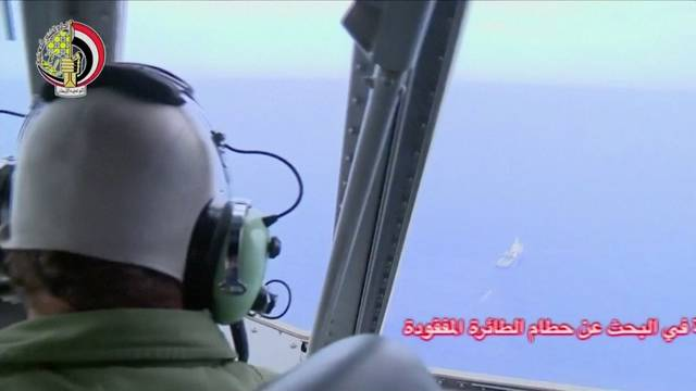 A pilot looks out of the cockpit during a search operation by Egyptian air and navy forces for the EgyptAir plane that disappeared in the Mediterranean Sea, in this still image taken from video