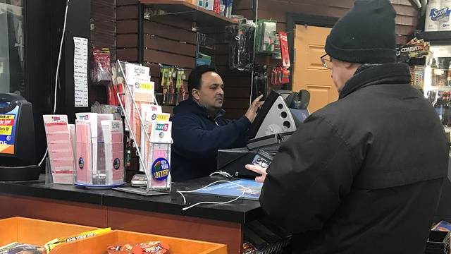 A lottery retailer sells Powerball and Mega Millions tickets to a customer in New York City