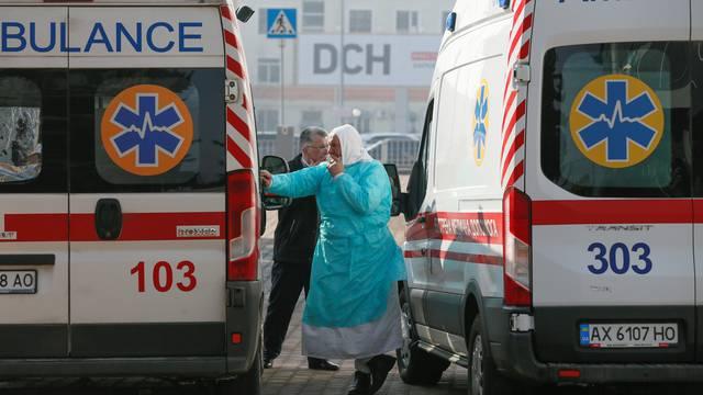 A medic smokes near ambulances in Kharkiv