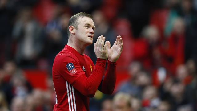 Manchester United's Wayne Rooney applauds fans after the game