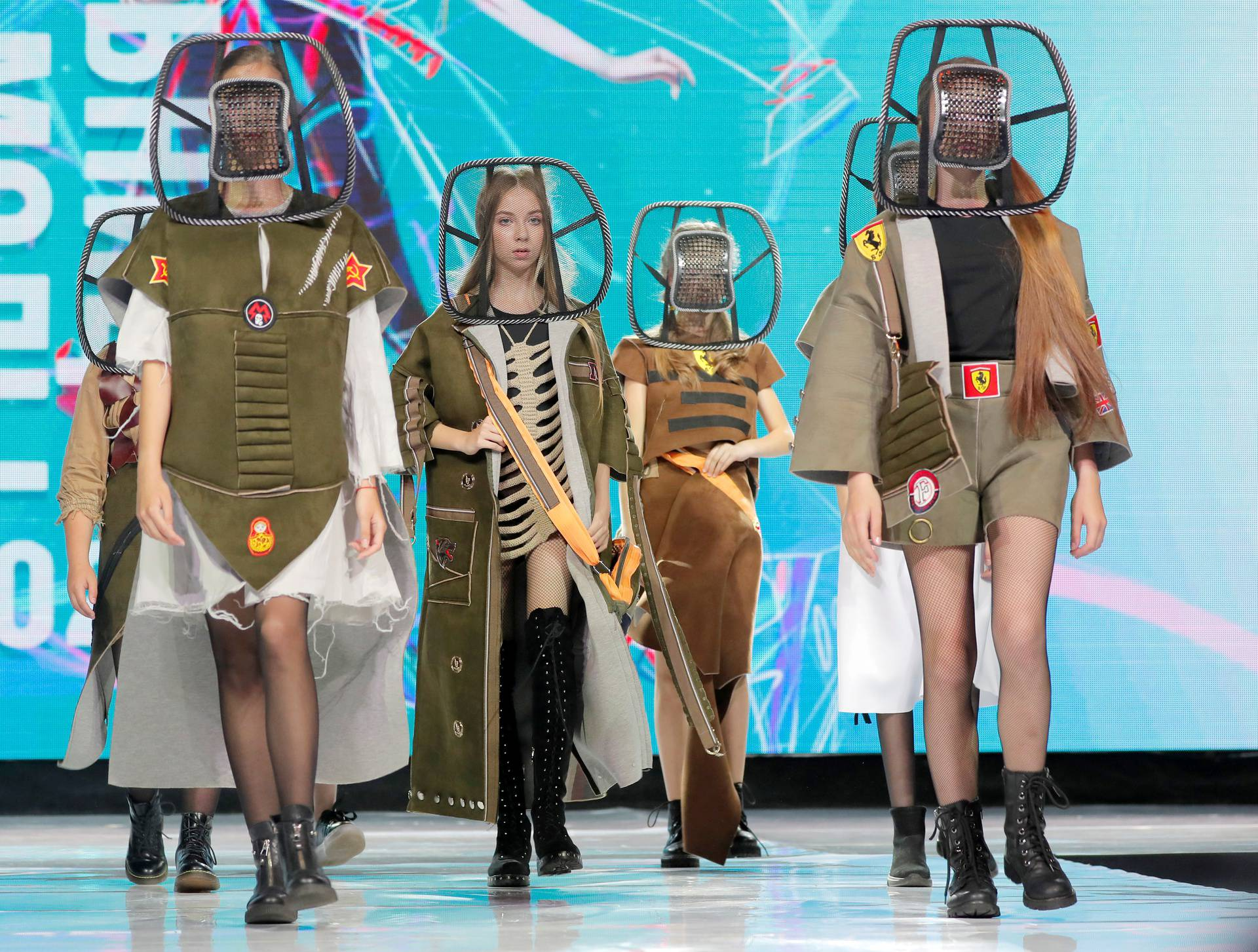 """Models present creations """"2033 (teens)"""" by Belarusian designer Kutepova during a show at the festival and contest ?Fashion Mill? in Minsk"""