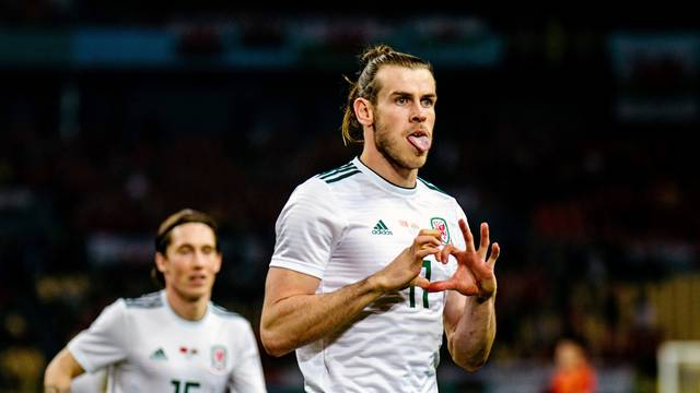 China Cup Semi-Finals - Gareth Bale of Wales celebrates after scoring a goal