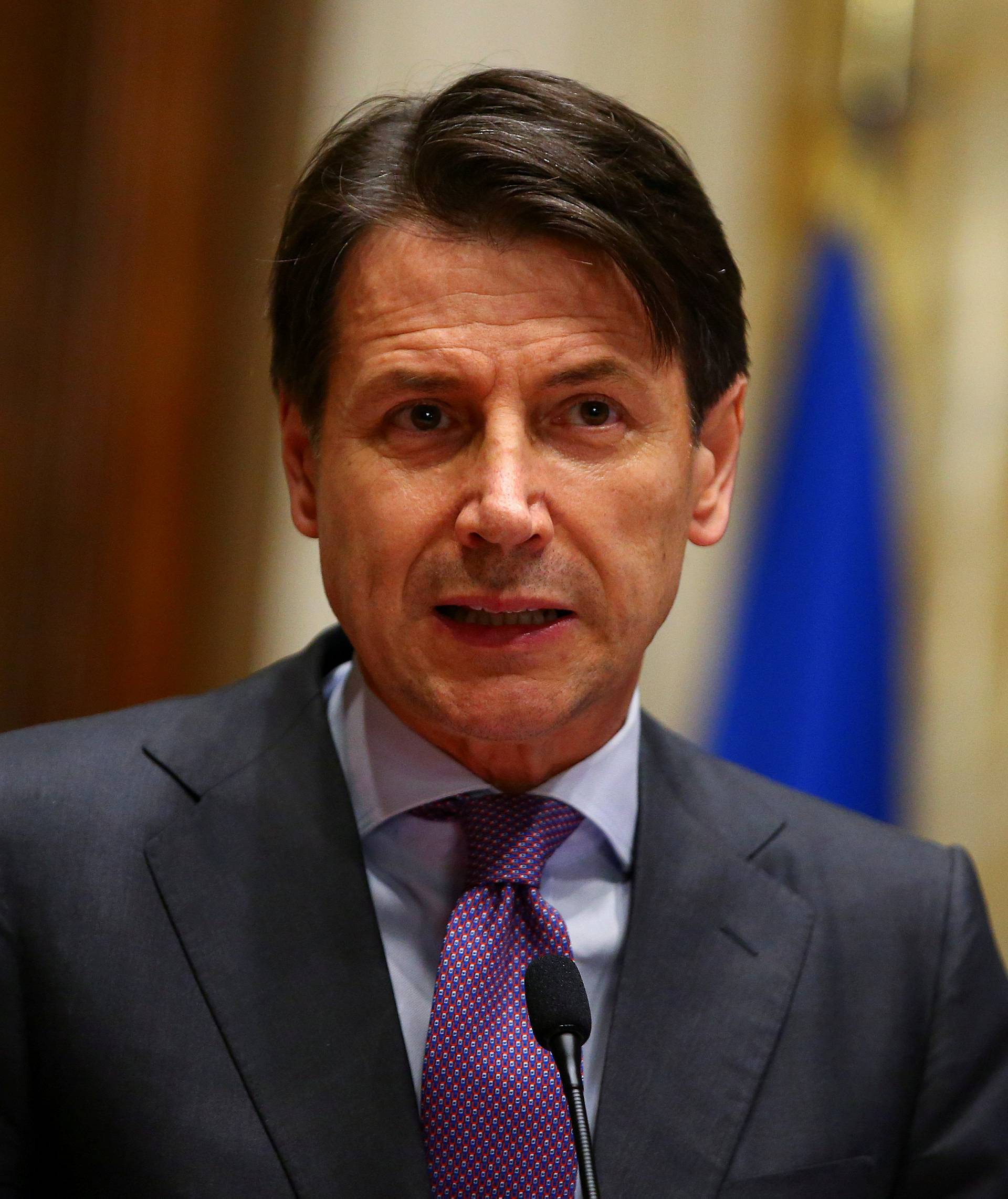 FILE PHOTO: Italy's newly appointed Prime Minister Giuseppe Conte speaks at the media at the end of a round of consultations with political parties at the Lower House in Rome