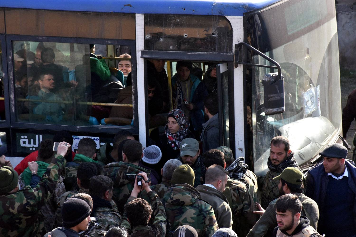 People who fled the Shi'ite Muslim villages of al-Foua and Kefraya arrive in government controlled Jibreen area in Aleppo