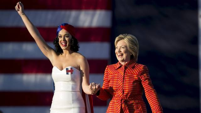 Democratic presidential candidate Hillary Clinton arrives with singer Katy Perry during a campaign rally in Des Moines, Iowa