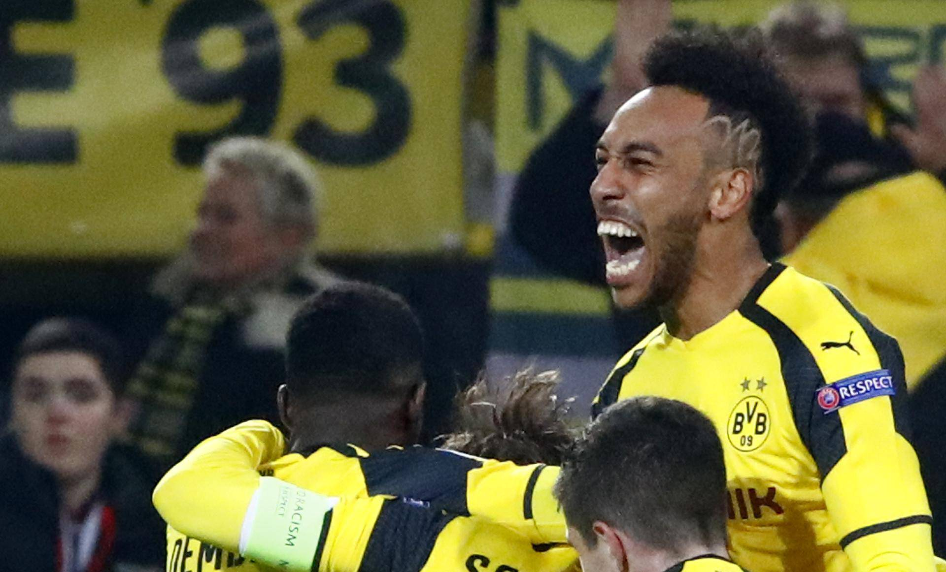 Borussia Dortmund's Pierre-Emerick Aubameyang celebrates scoring their third goal with team mates