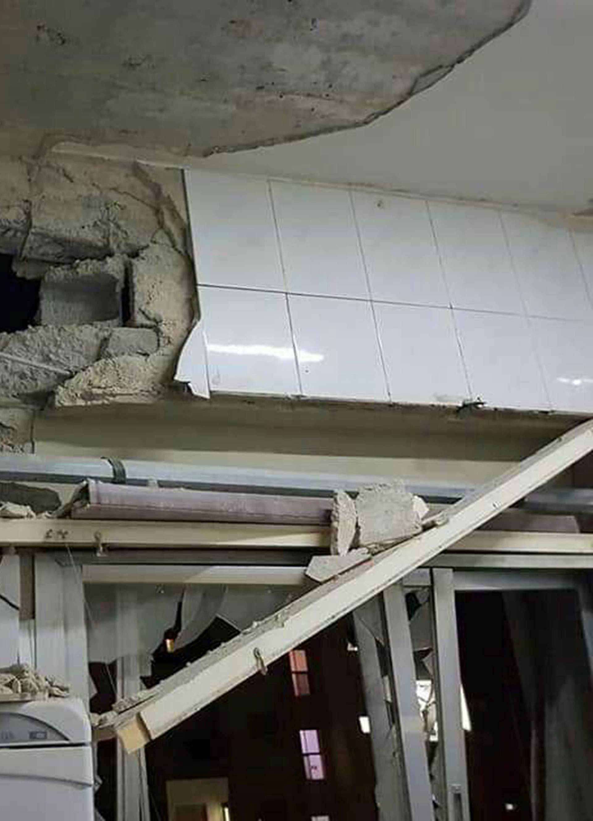 Damages are seen inside a house in Damascus