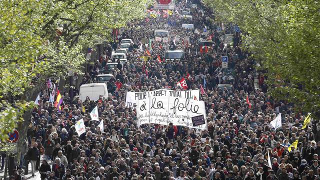 French labour union workers and students attend a demonstration against the French labour law proposal in Paris
