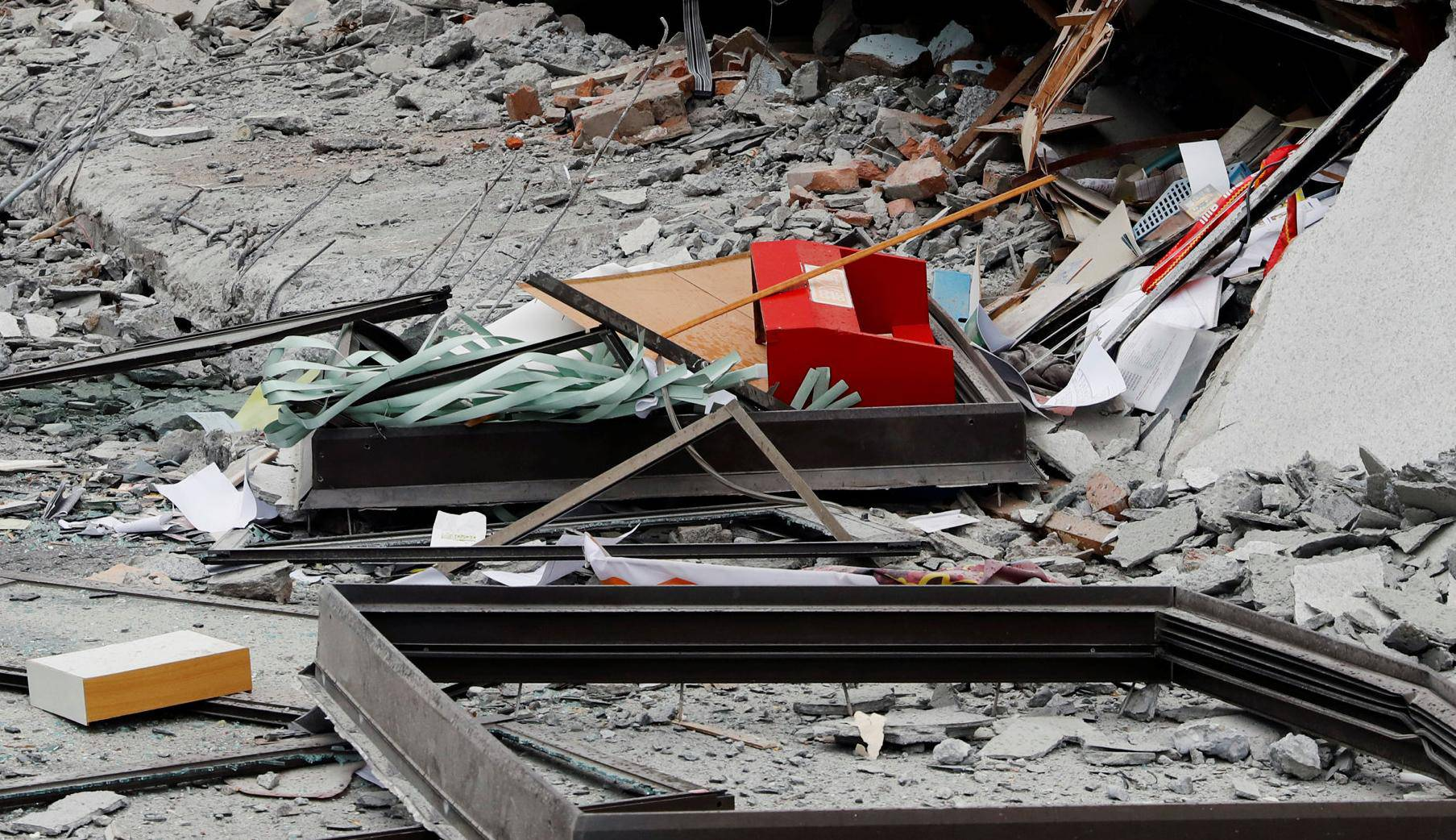 Debris are seen outside a damaged hotel after an earthquake hit Hualien
