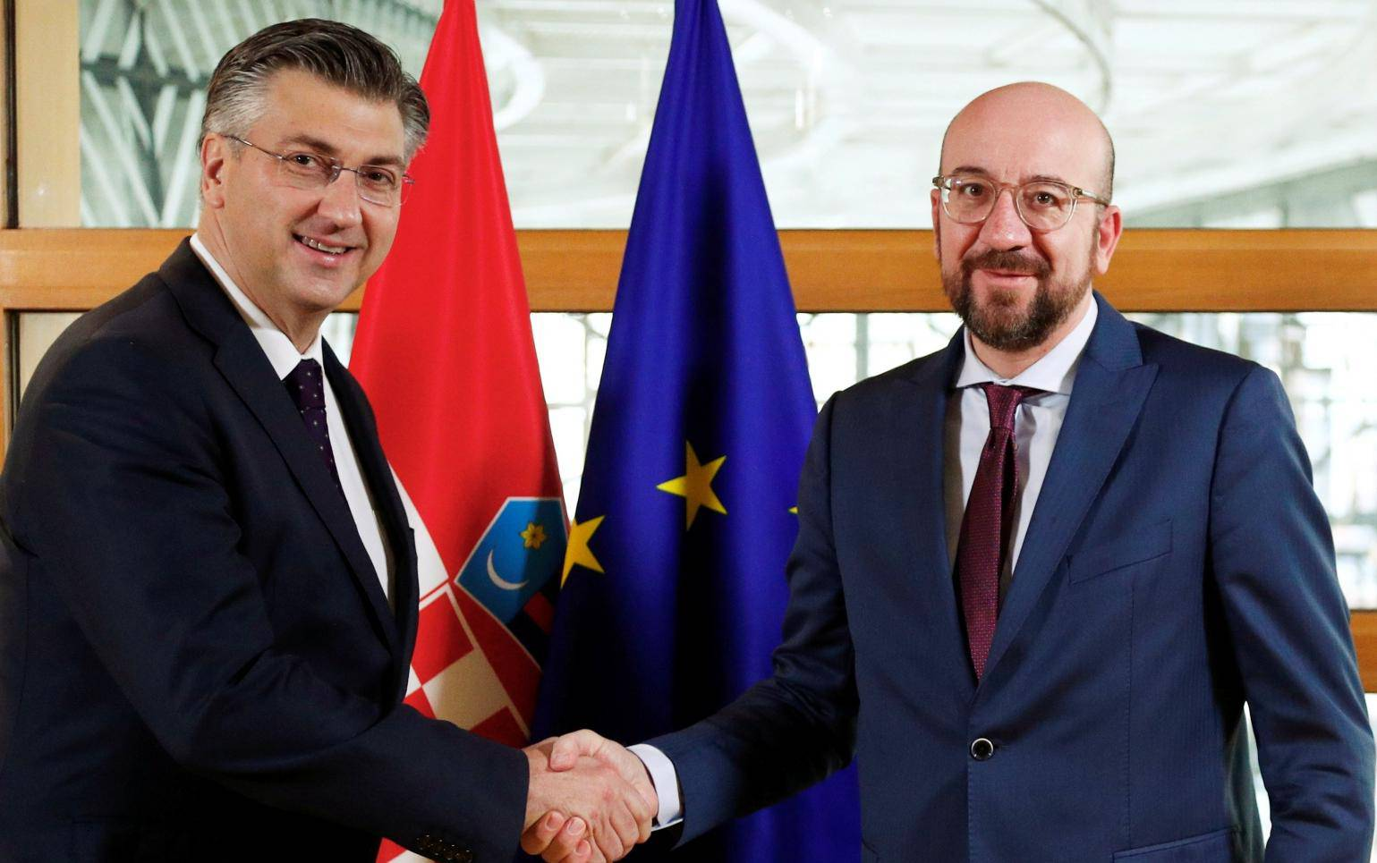 Croatia's PM Plenkovic shakes hands with EU Council President Michel in Brussels