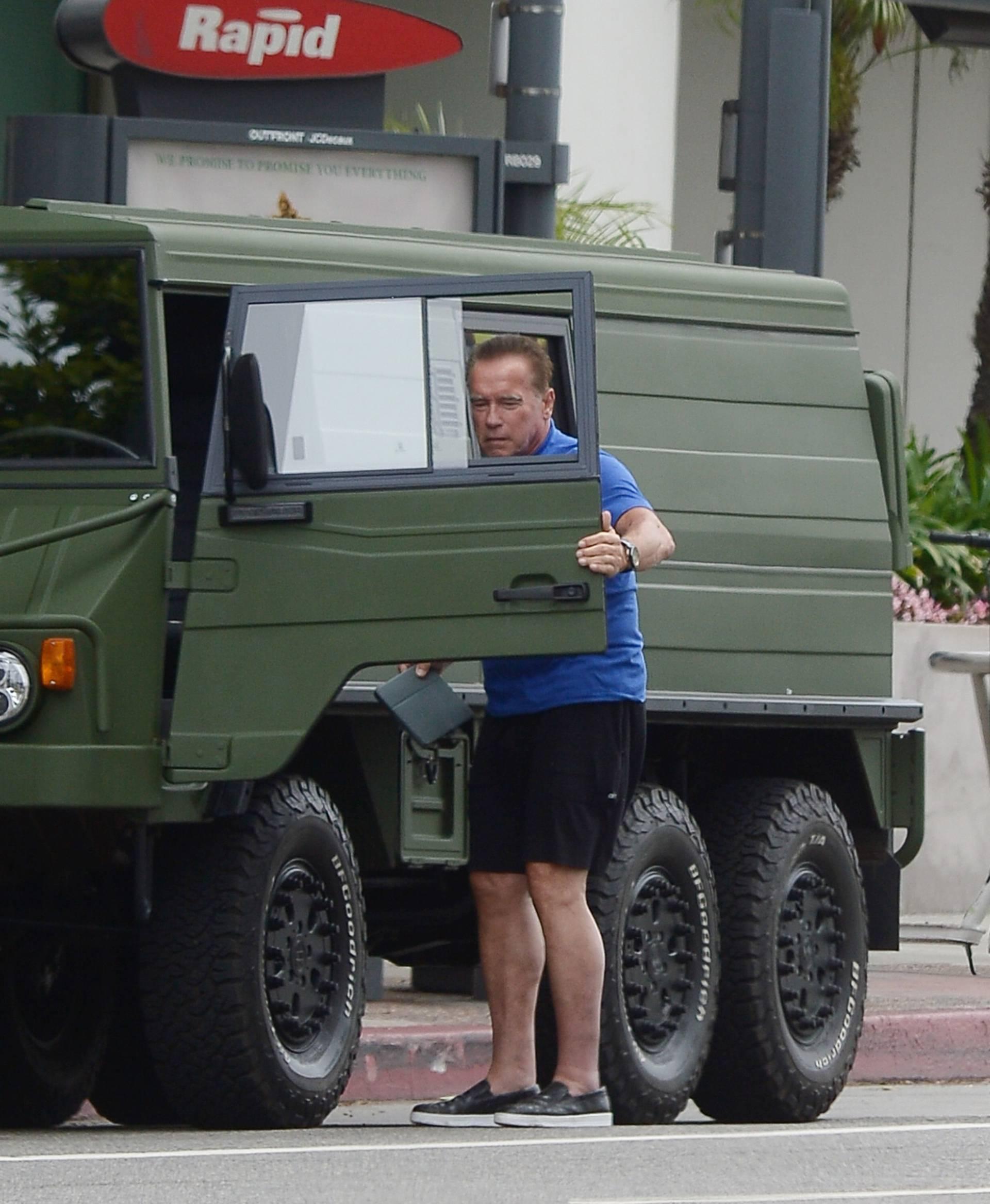 EXCLUSIVE: Arnold Schwarzenegger and Heather Milligan Run Errands in his New Military Truck.