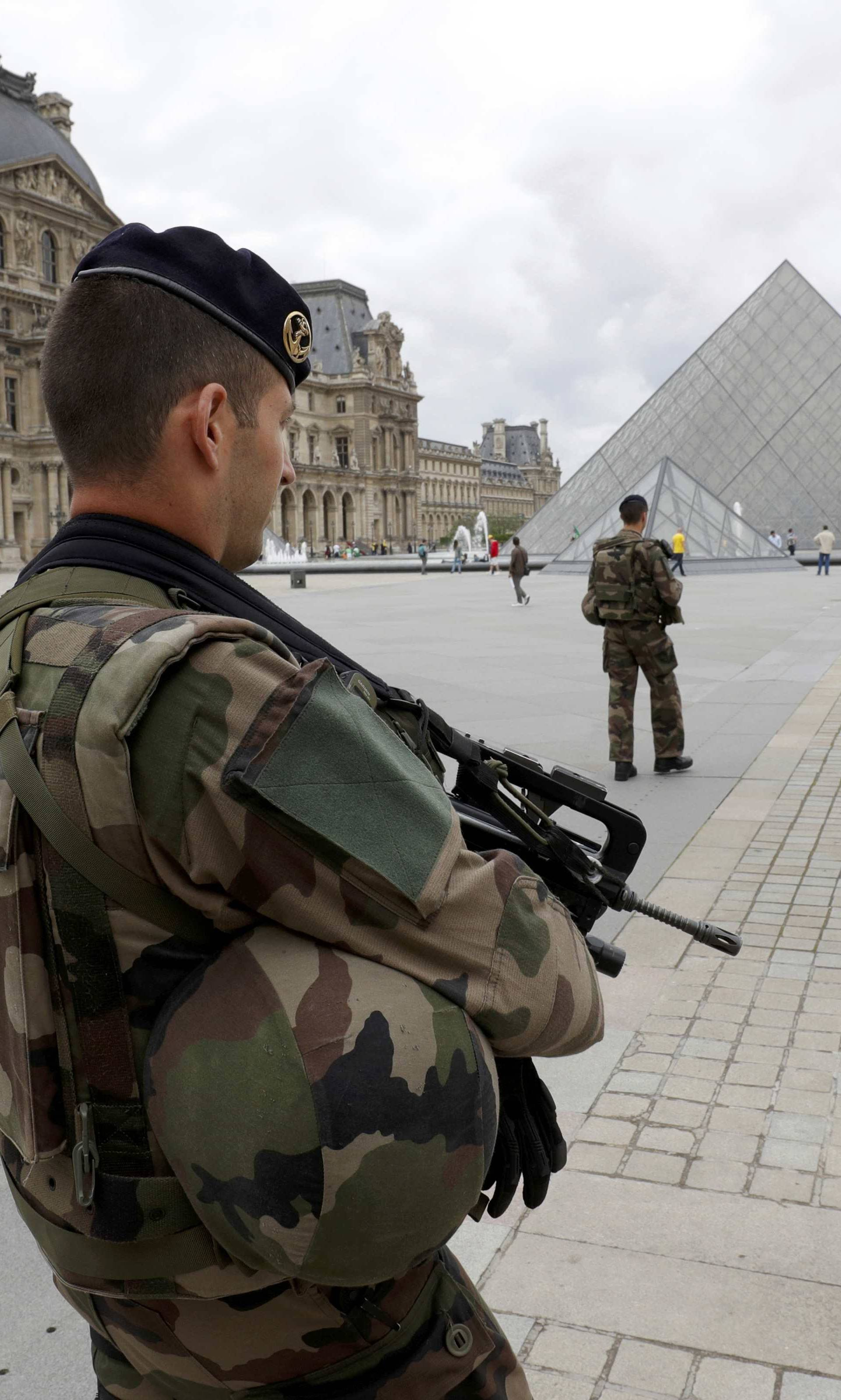 FILE PHOTO - French army soldiers patrol near the Louvre Museum Pyramid's main entrance in Paris