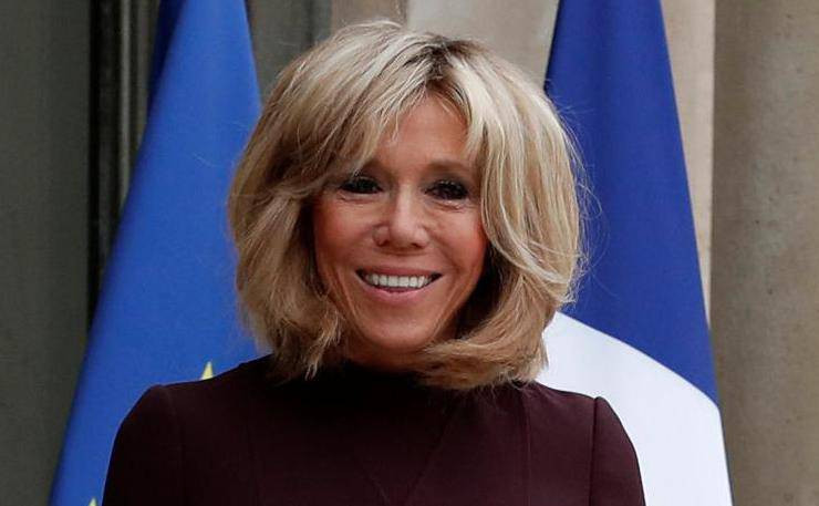 Brigitte Macron, wife of the French President, waits to welcome guests at the Elysee Palace in Paris