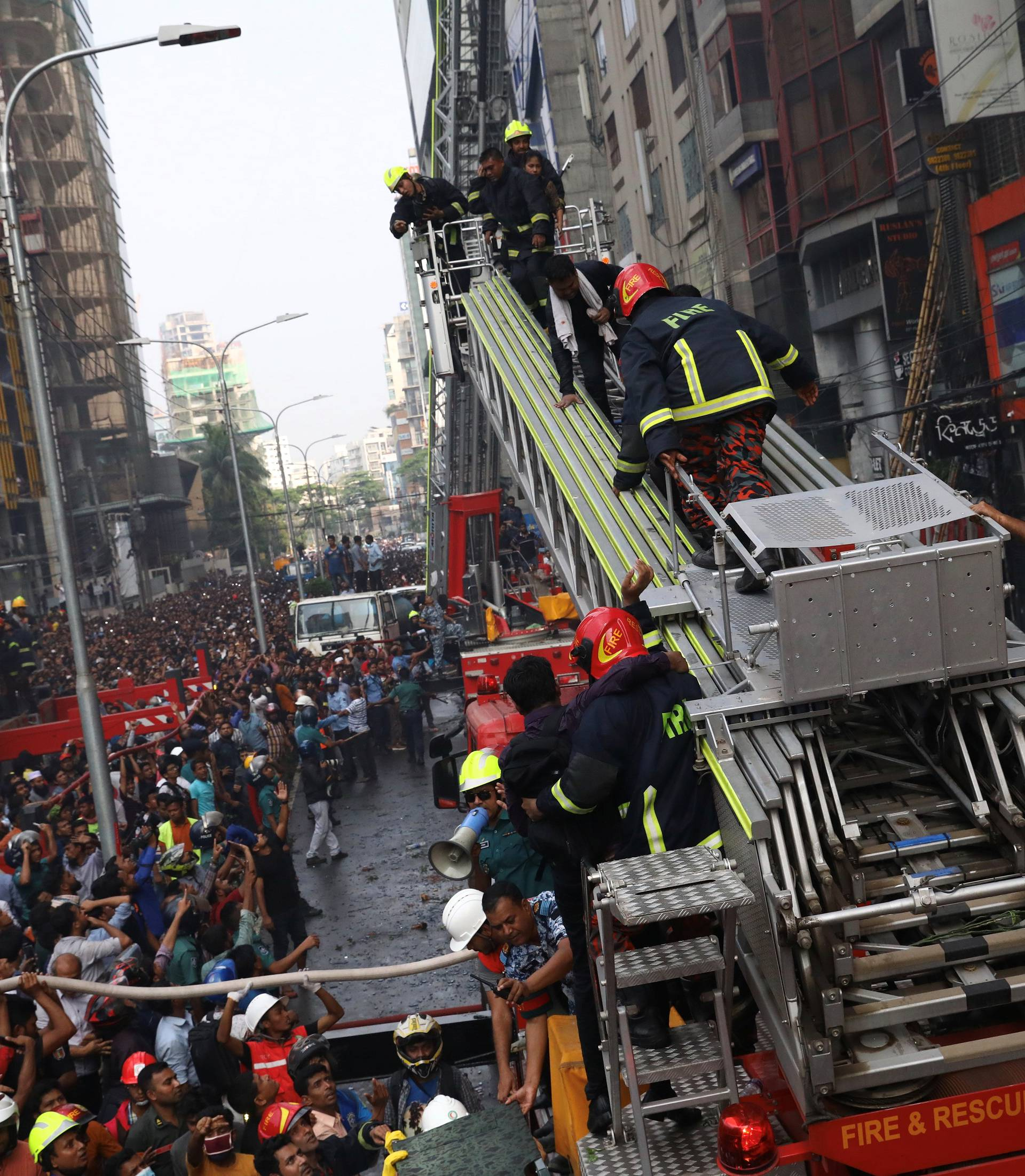 People are being rescued as fire broke out at a multi-storey commercial building in Dhaka