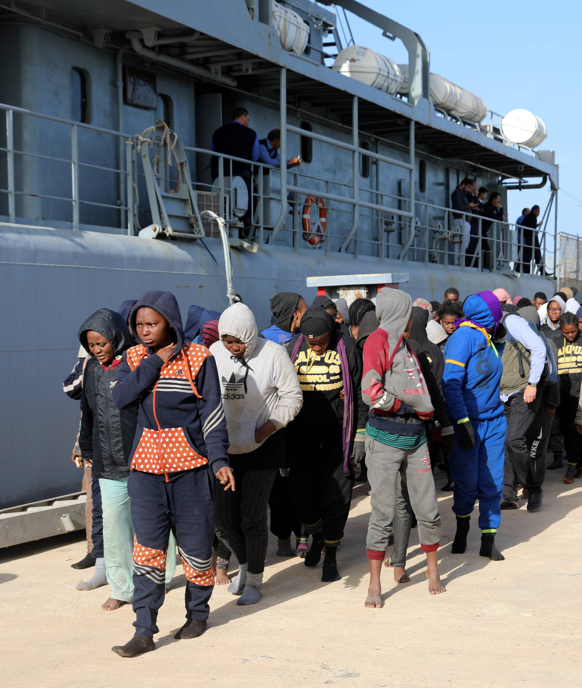 Migrants arrive at a naval base after they were rescued by Libyan coast guards, at a naval base in Tripoli