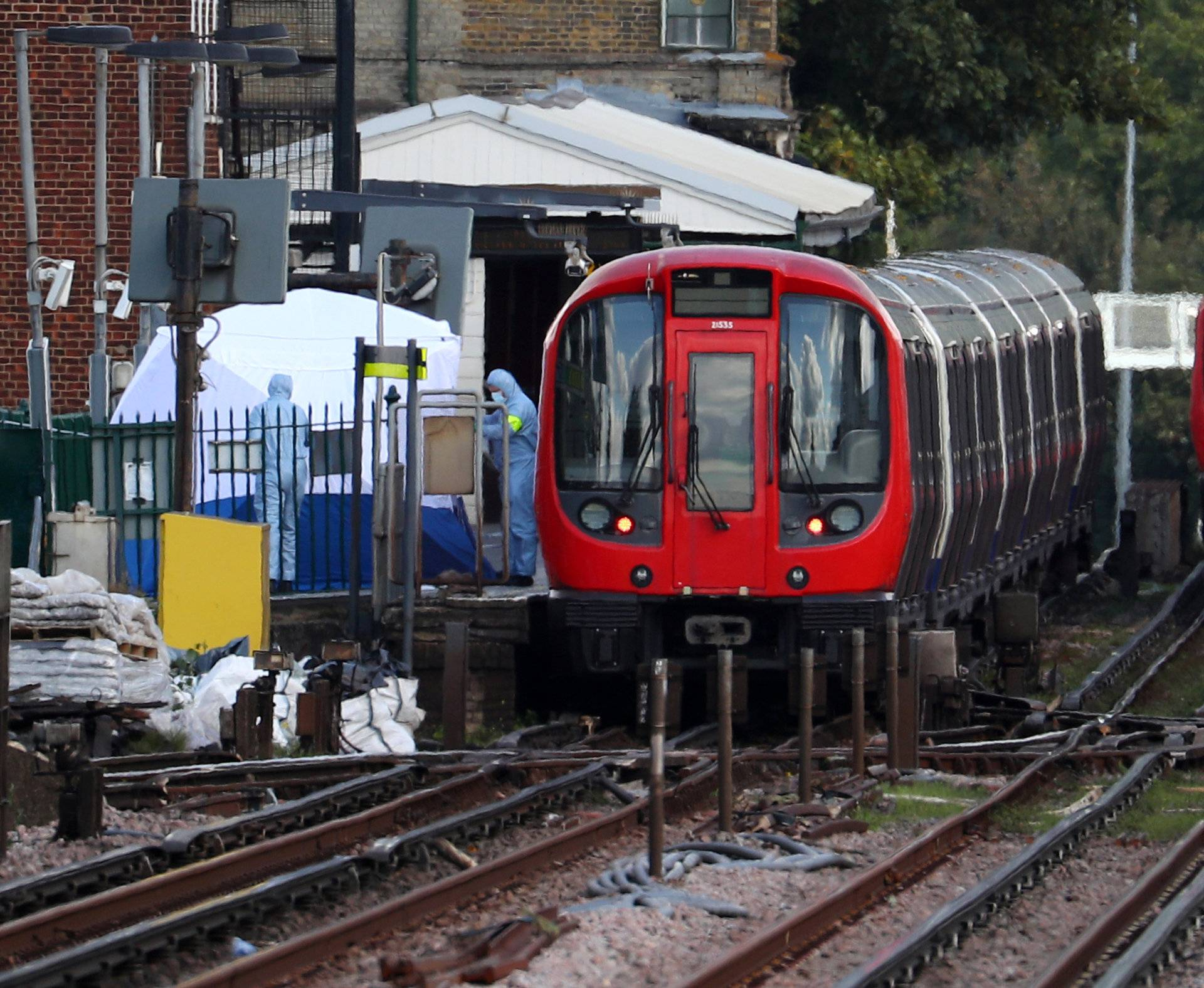 Forensic investigators search on the platform at Parsons Green tube station in London