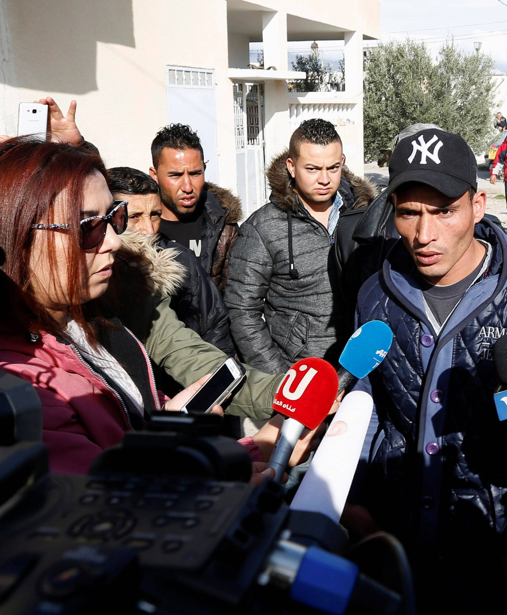 Walid, brother of suspect Anis Amri who is sought in relation with the truck attack on a Christmas market in Berlin, speaks to members of the media near their home in Oueslatia, Tunisia