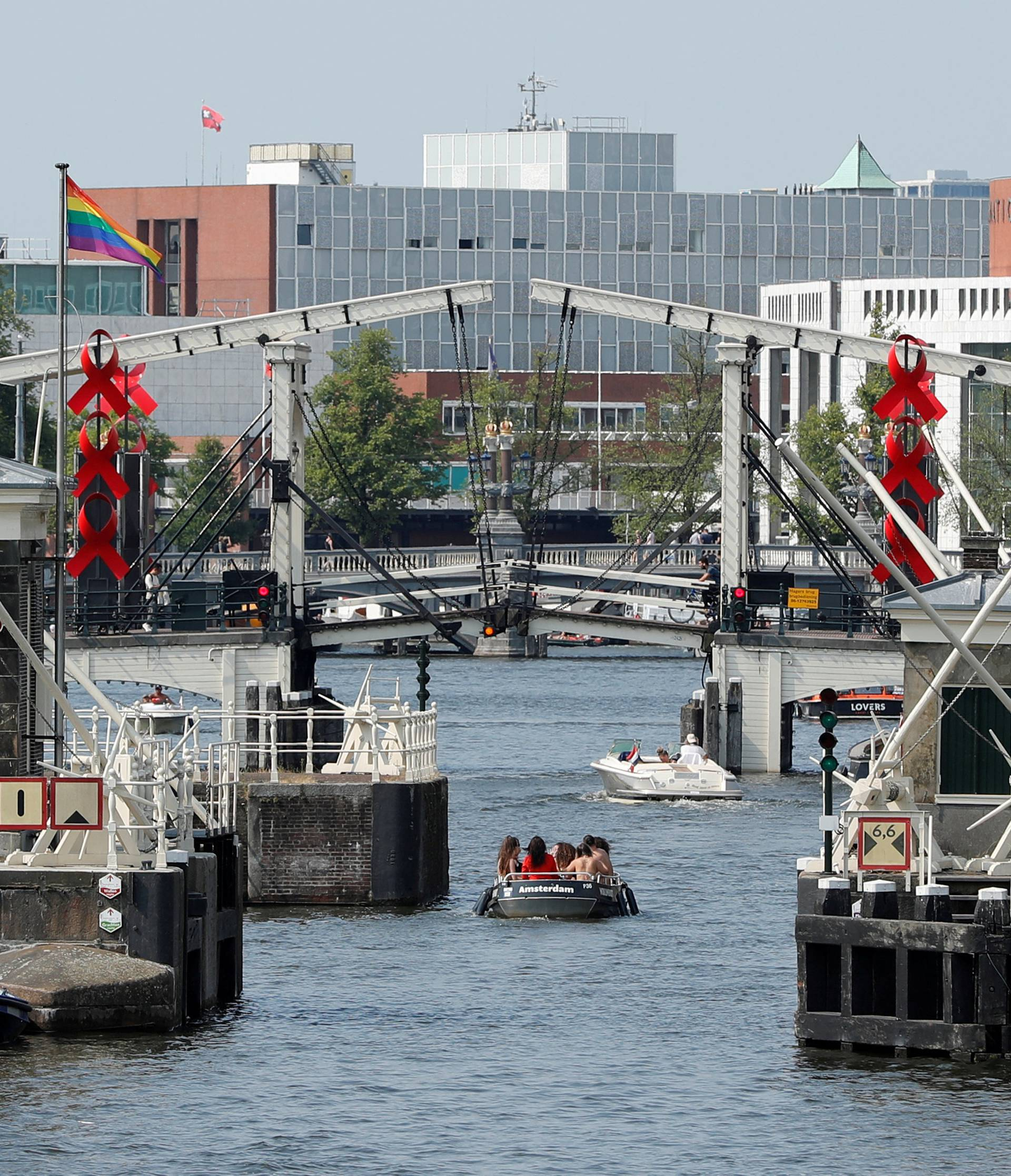 FILE PHOTO: A boat cruises past a bridge on a canal in Amsterdam