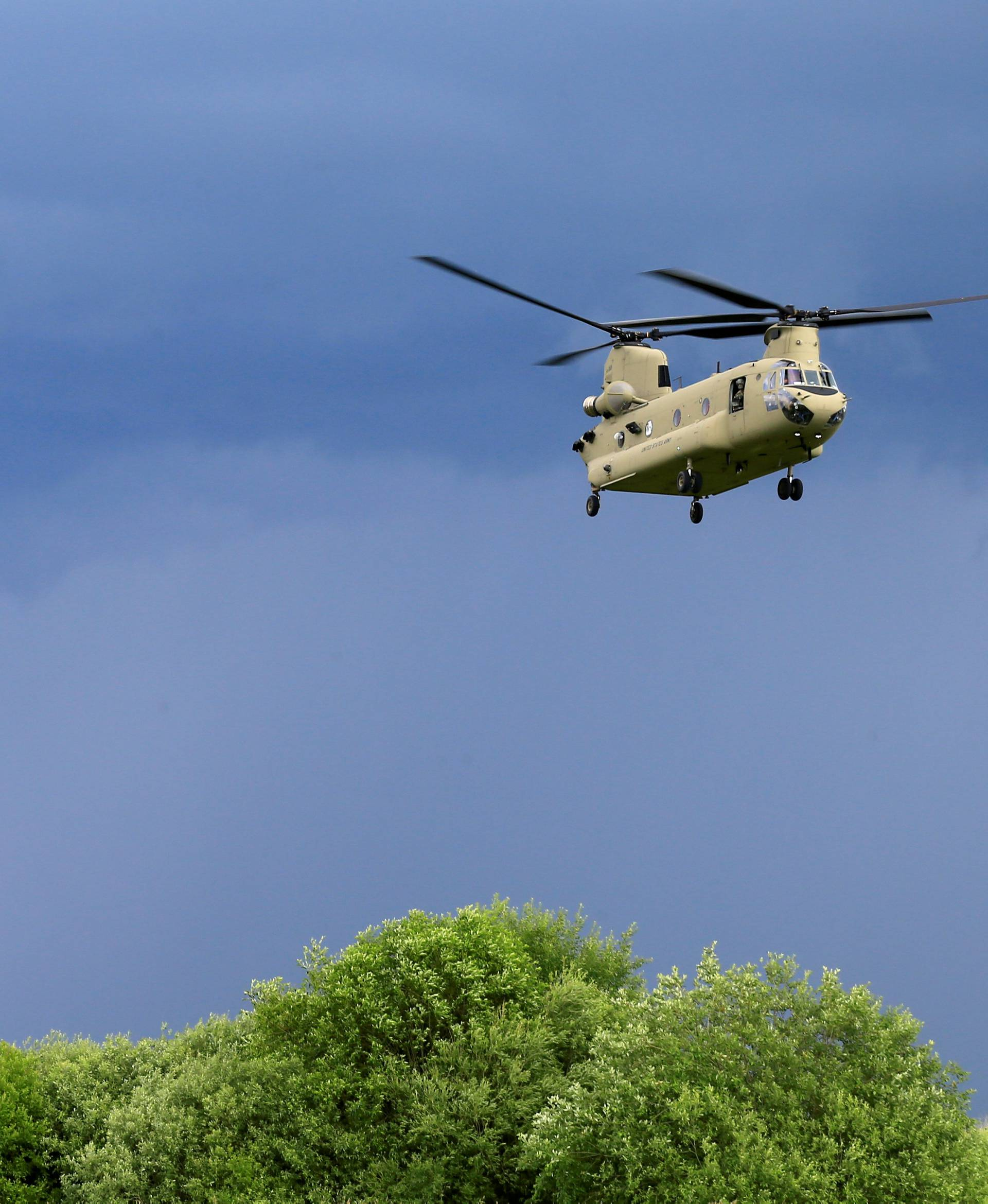 FILE PHOTO: U.S. CH-47 Chinook and Black Hawk helicopters take part in Suwalki gap defence exercise in Mikyciai