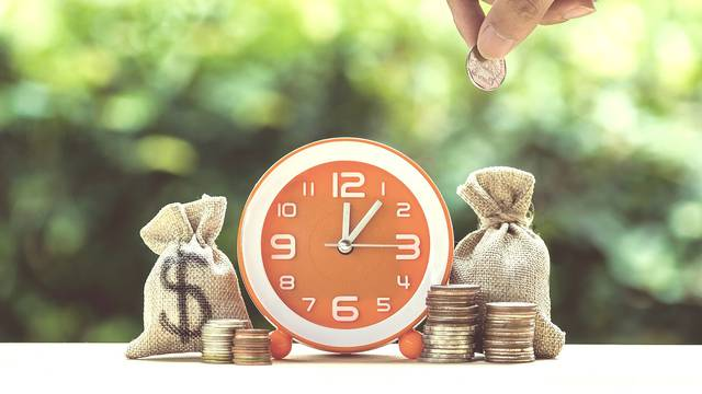 Money Savings, Investment, Time And Money Growing Concept : Hand