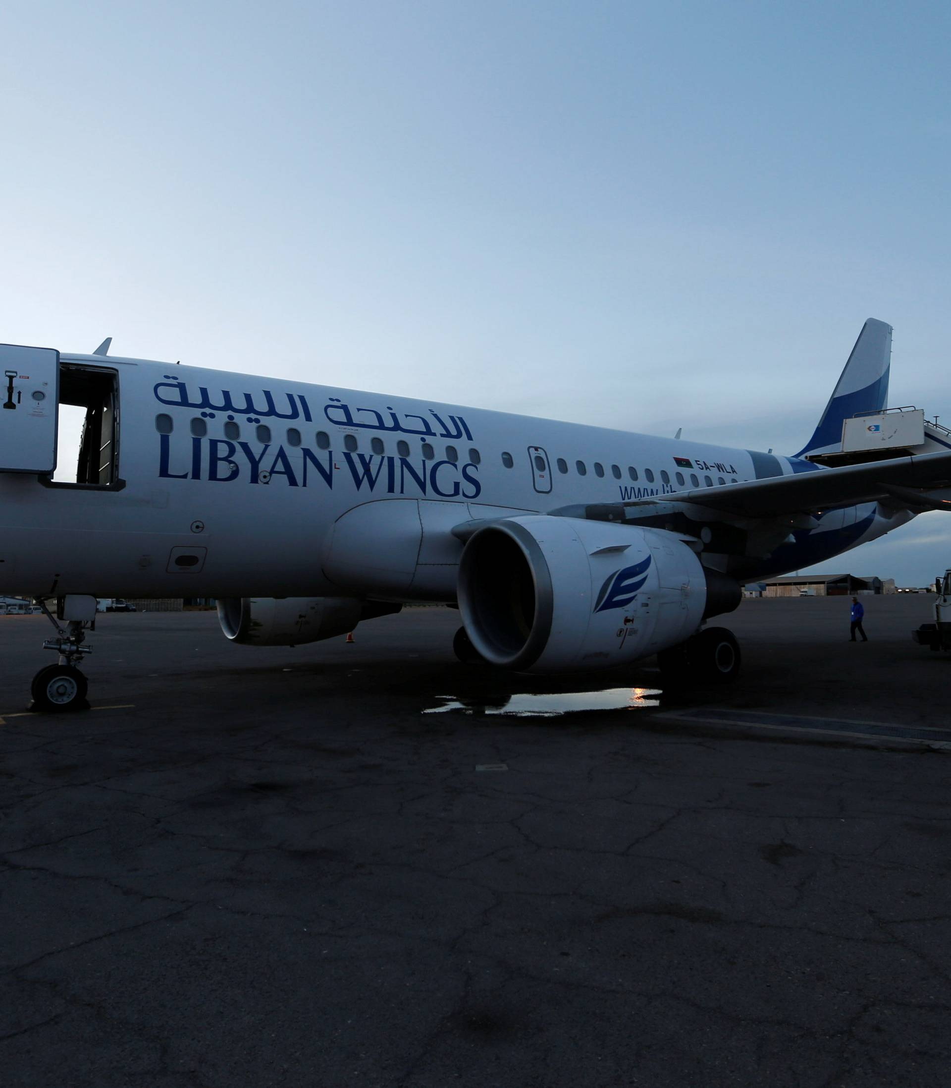 Plane, that was damaged during clashes, is seen at Mitiga airport in Tripoli