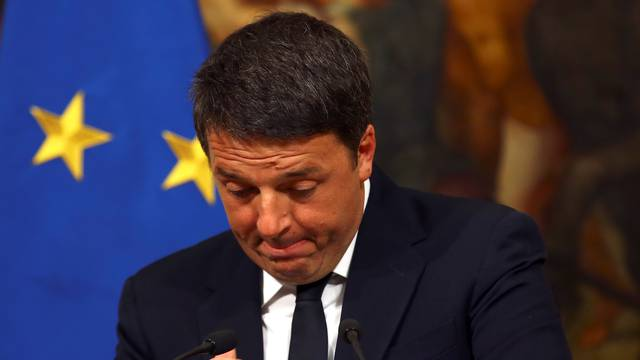 Italian Prime Minister Matteo Renzi gestures during a media conference after a referendum on constitutional reform at Chigi palace in Rome
