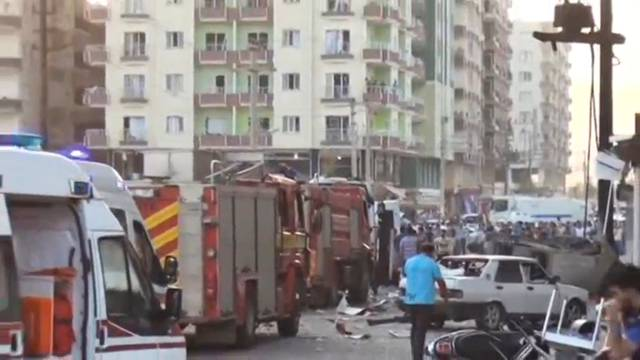 A still image taken from a video footage shows emergency vehicles at the scene of a bomb blast in Kiziltepe